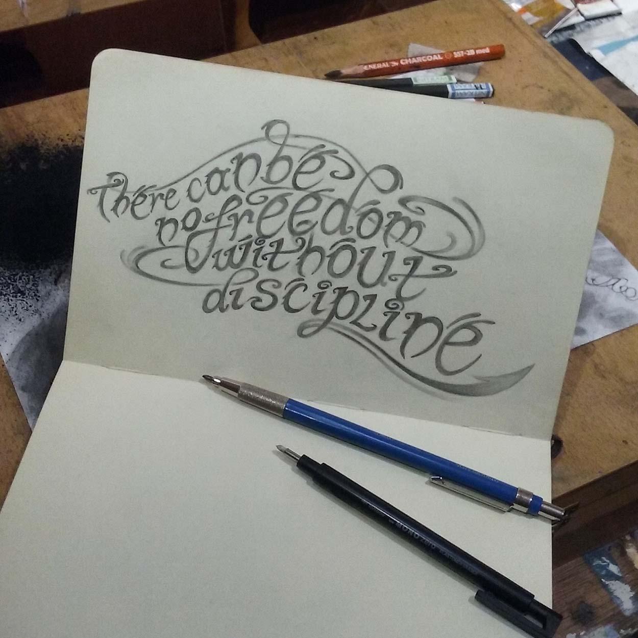 Handdrawn lettering in a moleskin sketch book.