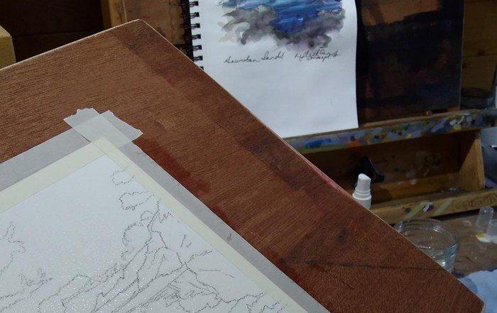 Watercolour in sketch pad of Saunton sands beach.